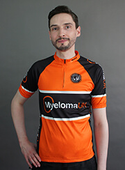 Man wearing the orange and black 2019 Ride cycle jersey